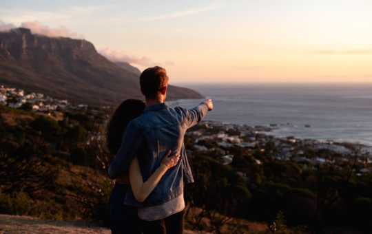 featured image of couple looking at beach for Bitcoin article