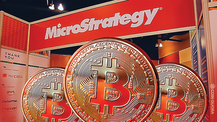 Picture of MicroStrategy with three bitcoins in front of it